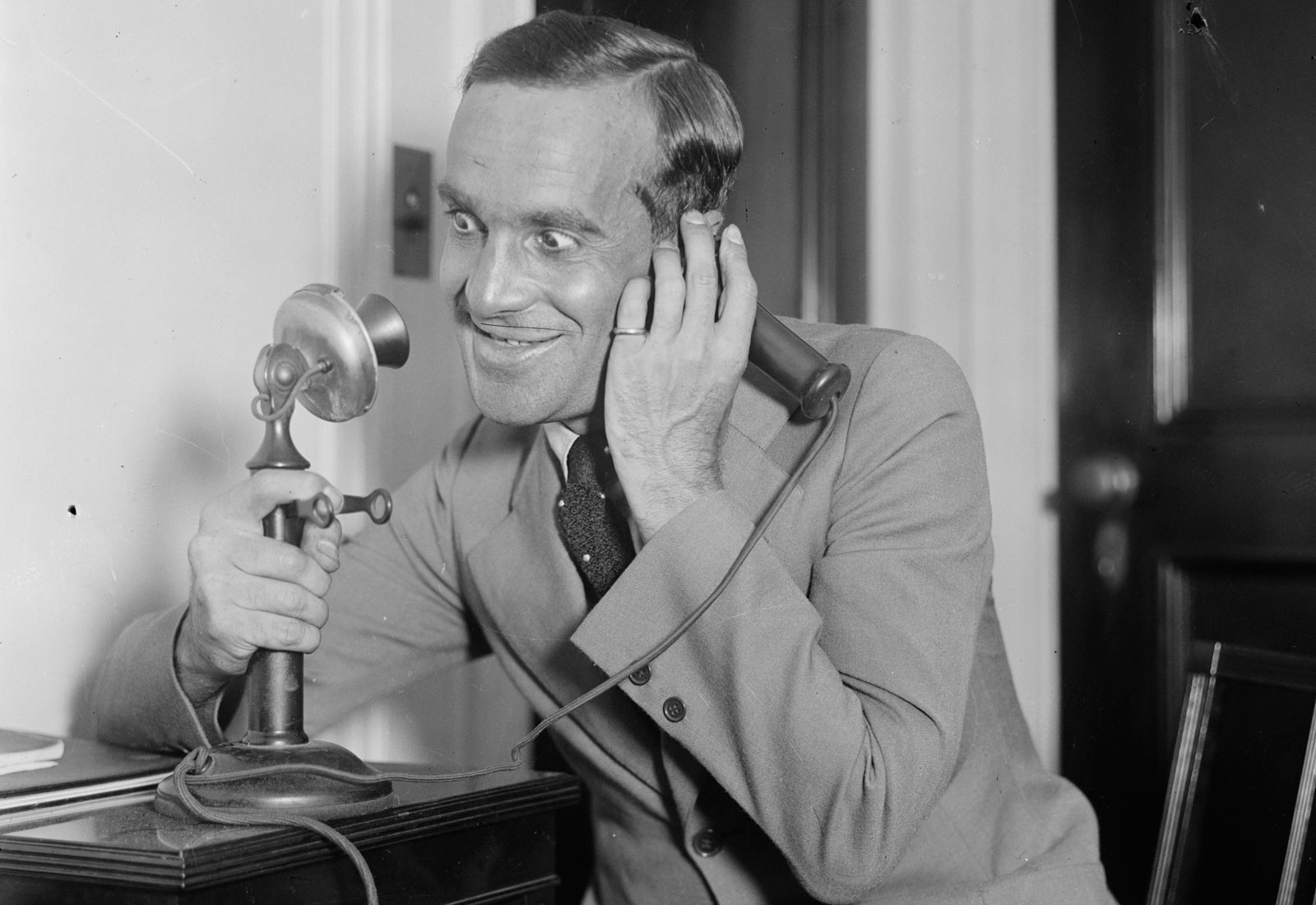 "Al Jolson using ""candlestick"" style telephone, 1910"