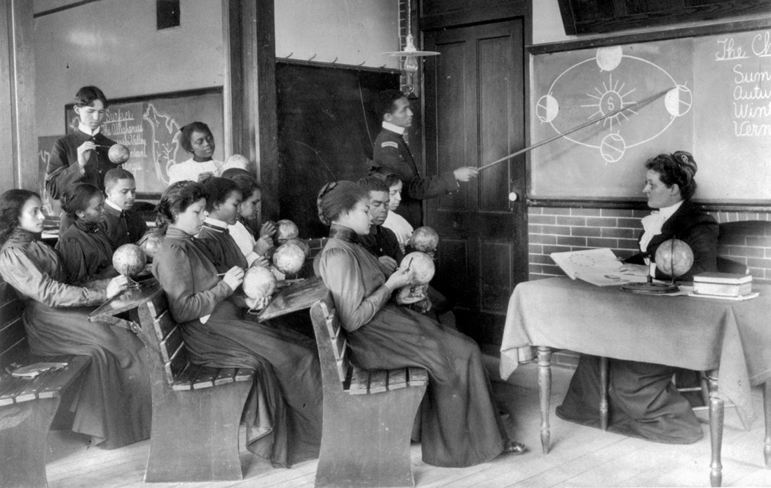 A class in mathematical geography studying earth's rotation around the sun, Hampton Institute. Hampton Virginia, 1899