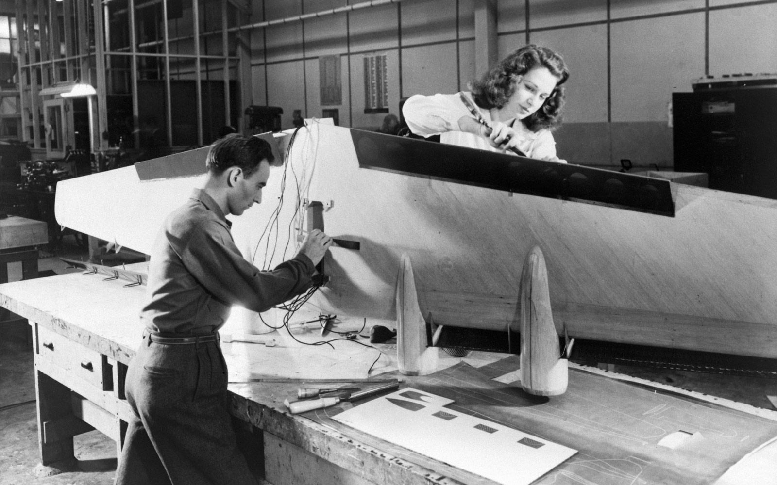 Technicians installing flaps and wiring on a flying-boat model. NASA, 1946.