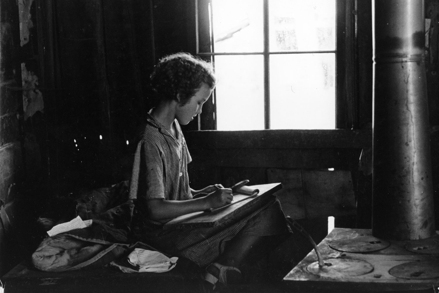The girl Lucille Kimbrell found a quiet place to practice writing, 1937.